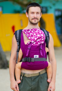 A dad wearing baby safely